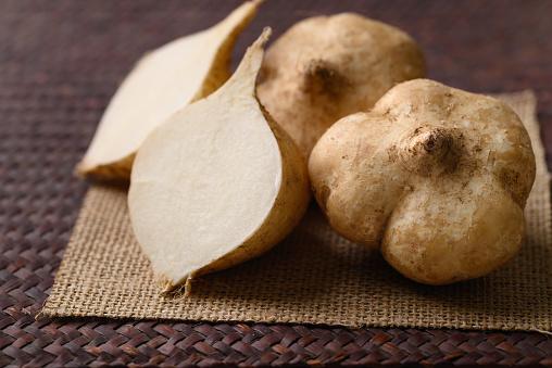 Fresh jicama or yam bean. Jicama can be eaten raw or cooked, The taste are crisp, juicy, moist, and slightly sweet